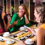 wpid-bigstock-Young-people-eating-sushi-in-A-76562810.jpg
